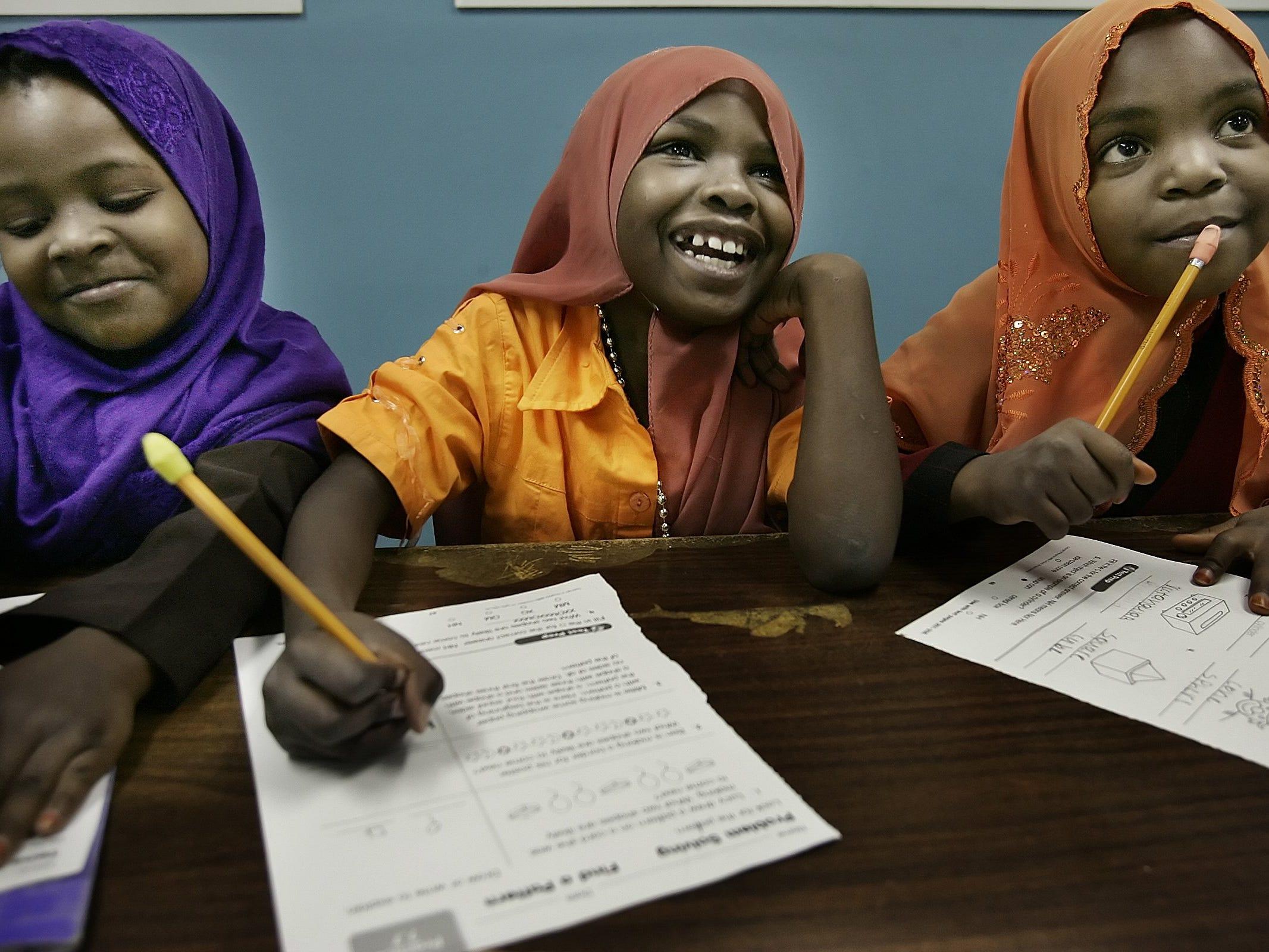 Shamsa Abdikadir, left, Rahama Bilal and Khadija Abdikadir study English at the CWA-Cayce Learning Center on Nov. 28, 2006.