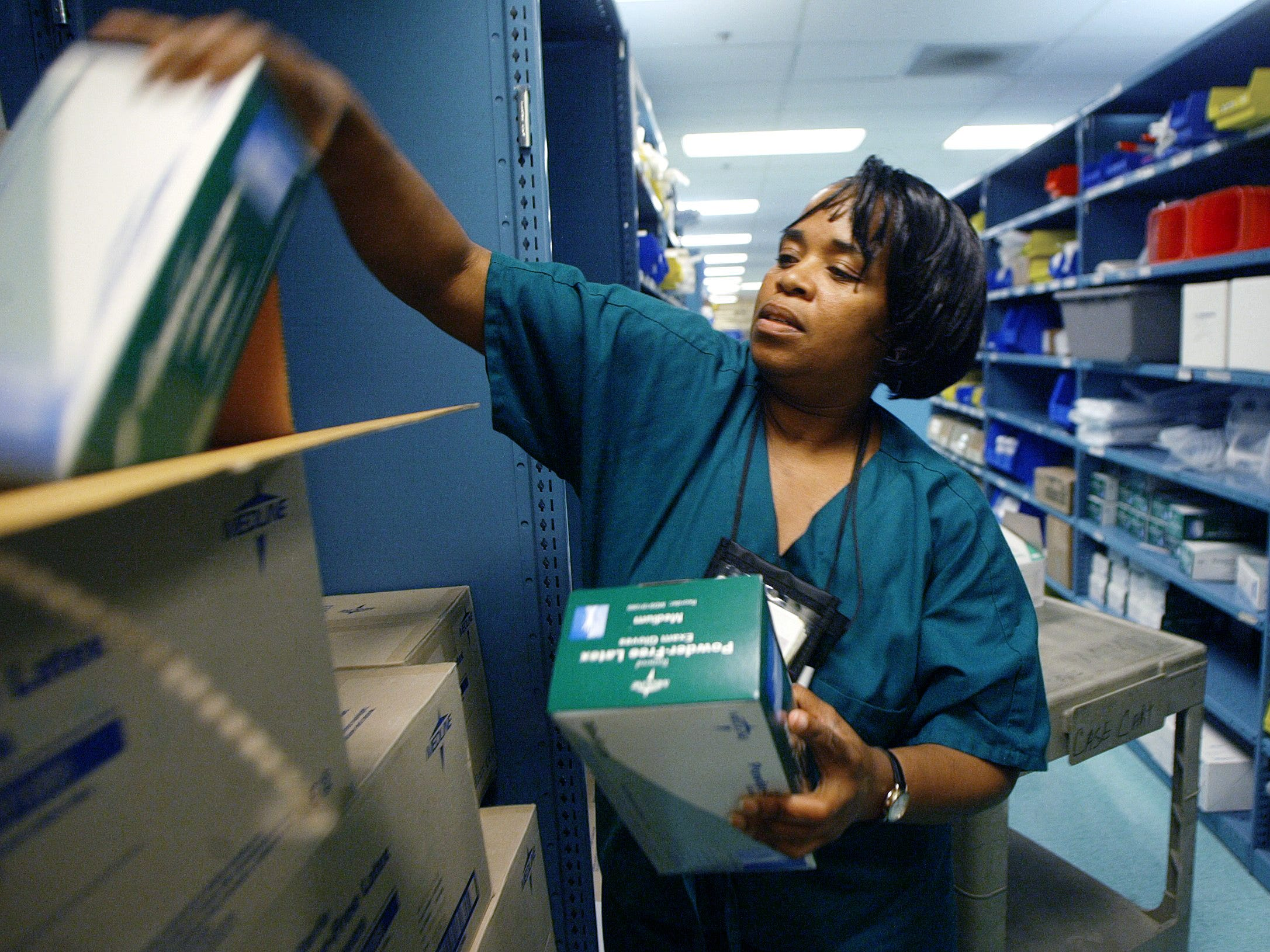 Clara Jenkins retrieves medical supplies from the stock room at Saint Thomas Hospital to be sent to treatment floors May 9, 2003. Jenkins is part of Saint Thomas' Jobs in Healthcare program, which helps employee residents of the James A. Cayce Homes.