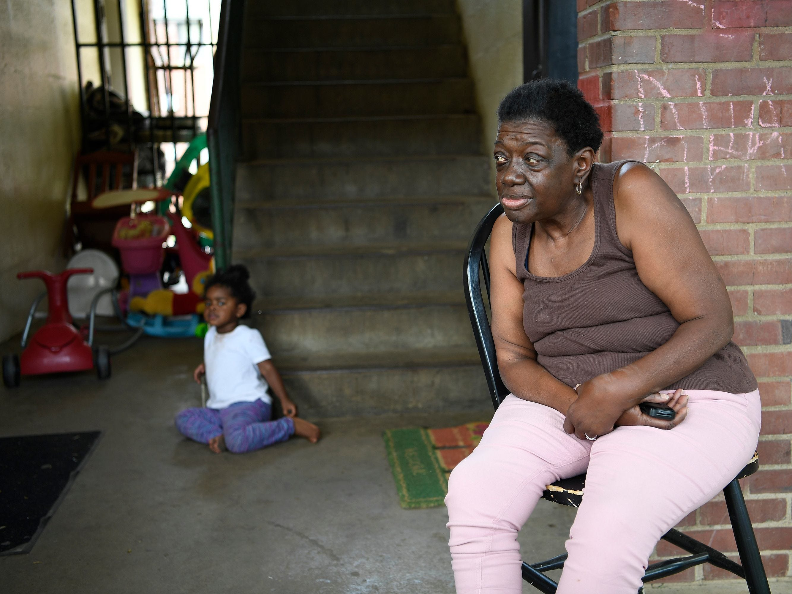 James A. Cayce Homes resident Shirley Payne, 68, sits with her great-granddaughter Marriana Simmons, 2, on May 12, 2017.