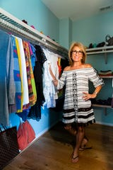 Professional organizer Marla Ottenstein stands in her carefully curated and neatly organized closet on Friday, Oct. 19, 2018, at her home in North Naples..