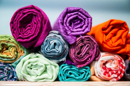 Professional organizer Marla Ottenstein: When it comes to storing scarves, the question is: to roll, foldor hang? My choice is to roll 'em.