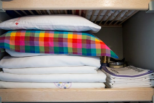 As space is very tight in my linen closet, I've set aside two shelves for bath towels (folded), beach towels (rolled), bed linens (neatly folded), pillowcases and boudoir pillows. I've also carved out a small space behind my sheets to store my collection of scented candles. Everything fits just right.  Here's a simple formula to figure out how many sheets and towels you need: no more than two sets of sheets per bed, two towels per person/per pillow (queen or king bed equals two people, equals four towels), two quilts/blankets per bed (one summer weight and one for winter), and no more than two pillows per person/per bed (queen bed equals two people, equals four pillows).  If you end up with mismatched towels and sheets, consider donating them to your local humane society, where they will be used to keep the foster dogs and cats warm.