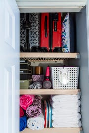 Professional organizer Marla Ottenstein's linen closet at her home in North Naples.