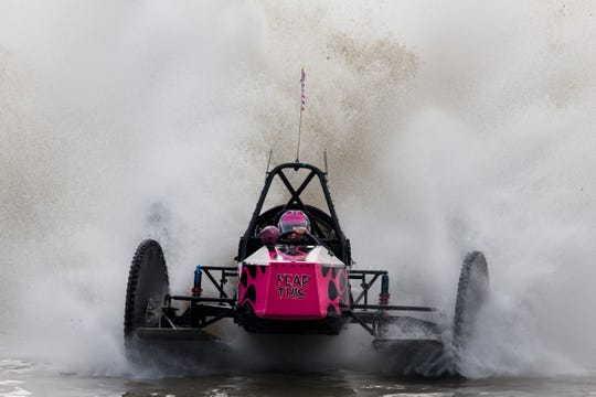 Fatal Attraction driver Bonnie Walsh crosses the finish line to win the Big Feature during the Budweiser Winter Classic swamp buggy races at Florida Sports Park in Naples in Jan. 2017.