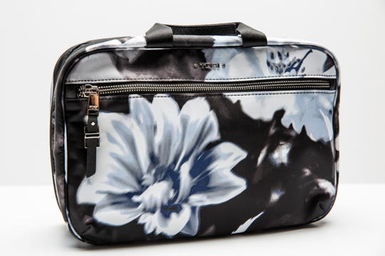 Professional organizer Marla Ottenstein's Voyageur Madina case folds up into a compact toiletry bag.
