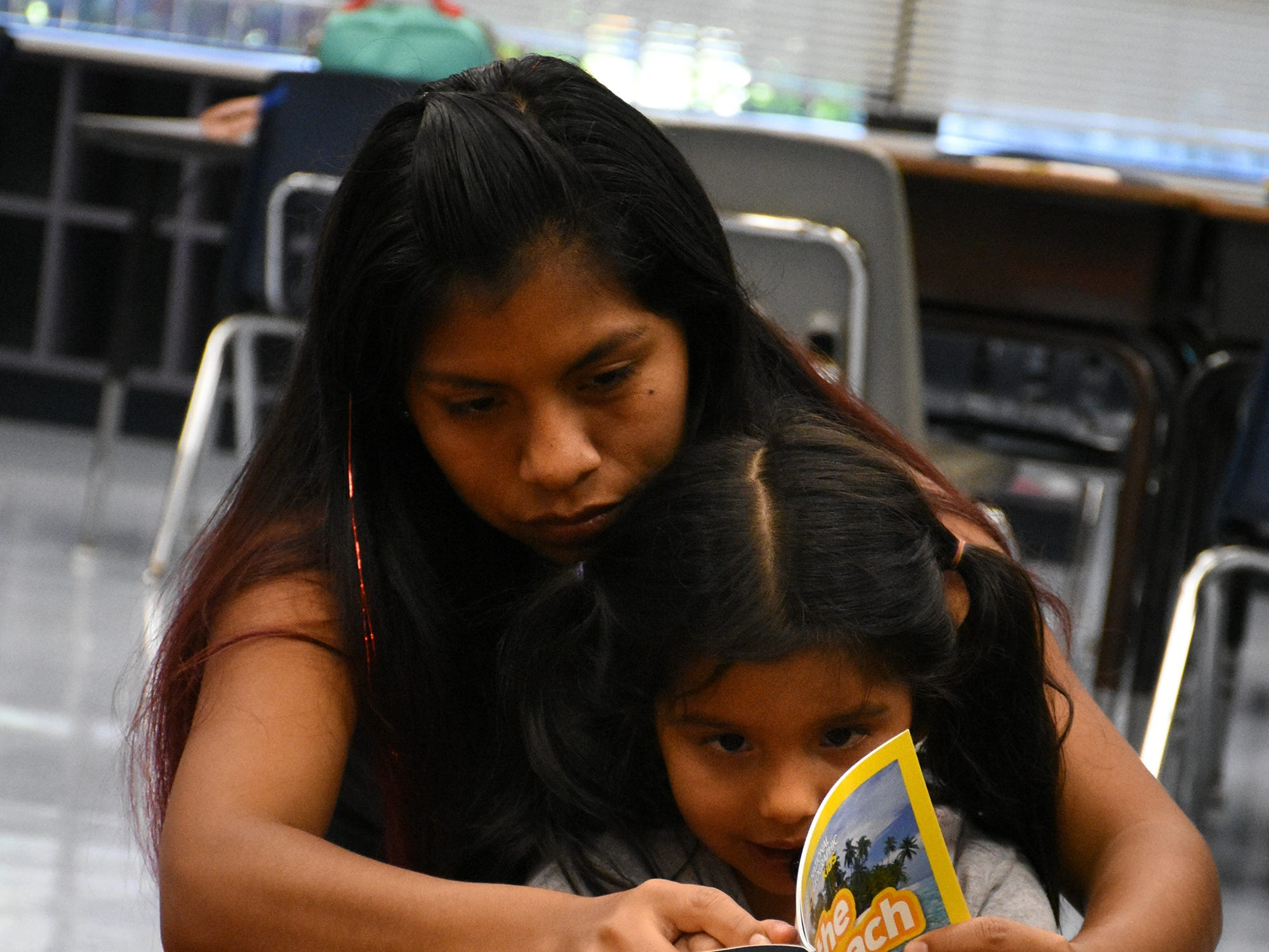 "Griselda Guzman reads with her daughter Allyson. Volunteers conduct ""Children and Parents Reading Together"" programs with pre-K students in elementary schools through the Literacy Volunteers of Collier County."