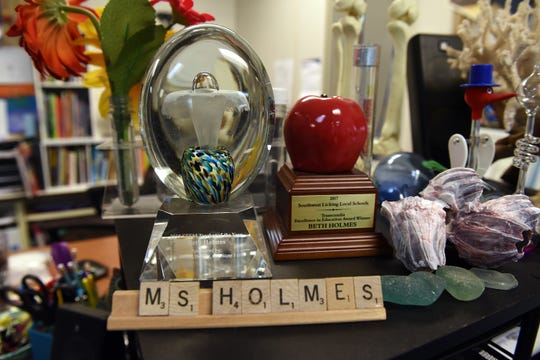 Teaching awards won by Beth Holmes including the 2018 STEM Educator of the Year Award.