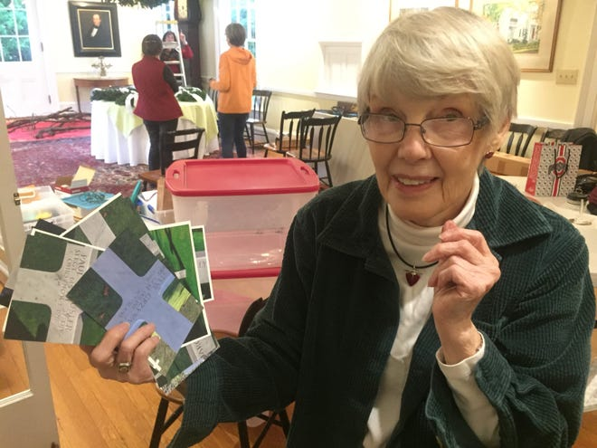 Becky Dungan, who helped prepare the exhibits, recently returned from a month's visit to Germany and spent a week in Belgium. She also visited Flanders Fields. Here she displays images of markers there.