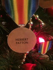 One of the many replica medals hanging on a Christmas tree honoring those from Licking County who fought and died in WWI.