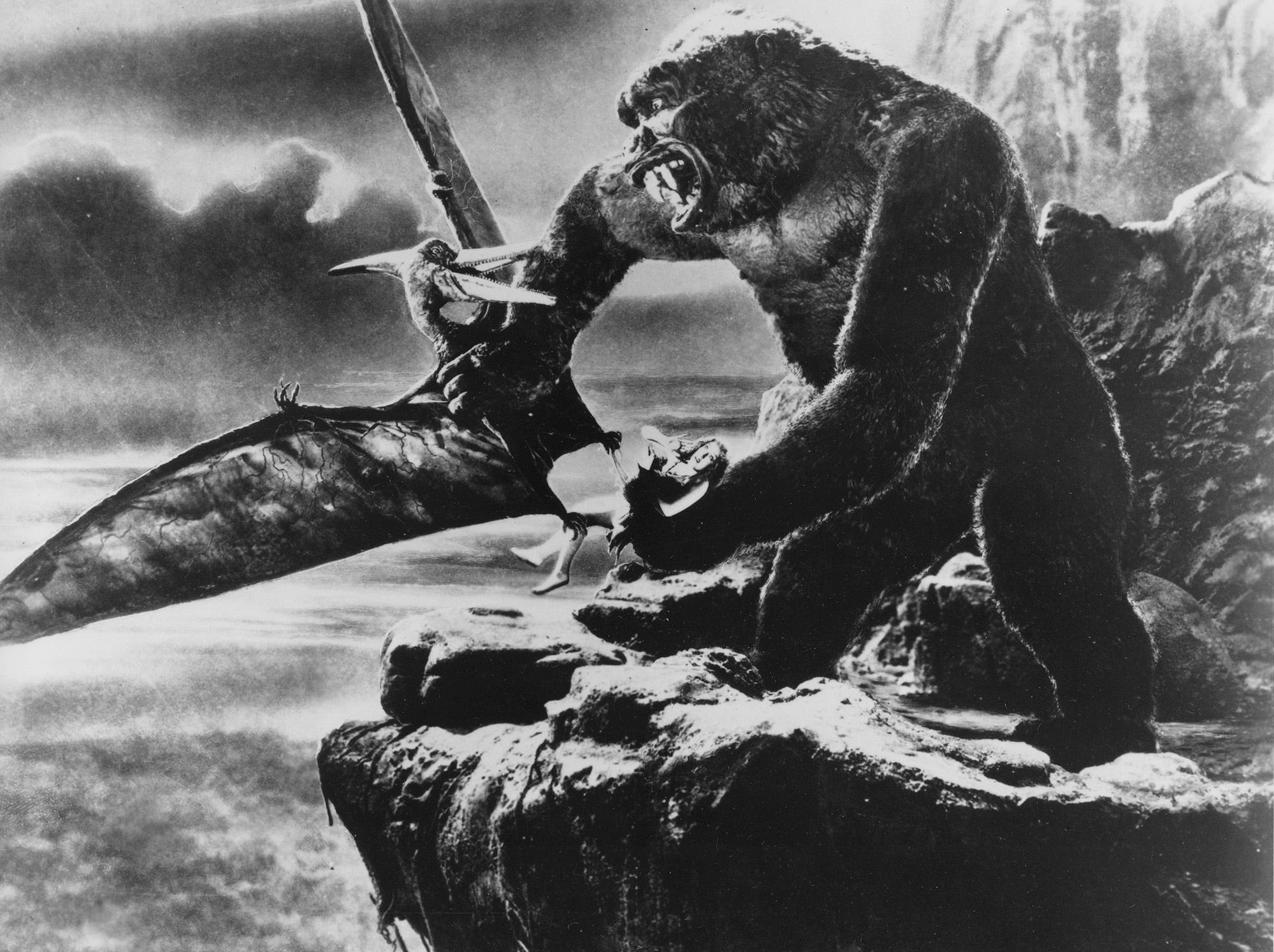 """**FILE**King Kong battles a prehistoric pteradactyl with one hand as he holds actress Fay Wray captive in the other hand in a scene from the 1933 film """"King Kong."""" Wray, 96, died Sunday, Aug.8, 2004,  at her Manhattan apartment, said Rick McKay, a friend and director of the last film she appeared in.(AP Photo)"""