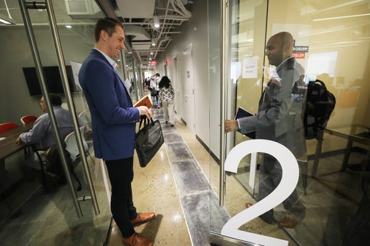 Mike Glaicar of Howell, founder and CEO of Trueconnect, a company that offers sales assistance, is about to enter the office of his next potential investor while he waits for AJ Jain, who makes Ongo Energy Spray, to exit. Jain had met with a the investor from Robin Hood Ventures.