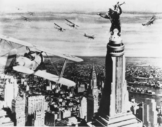 """""""King Kong stands atop New York's Empire State Building as he holds an airplane during an attack by fighter planes in a scene from the 1933 film """"""""King Kong.""""""""  (AP Photo)"""""""