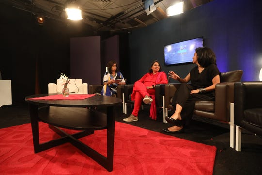 """Neha Mahajan, left, on the set of """"Center Stage,"""" the show she hosts for TV Asia, with Shruti Kapoor, an economist, and Vaishali Sinha, an independent filmmaker."""