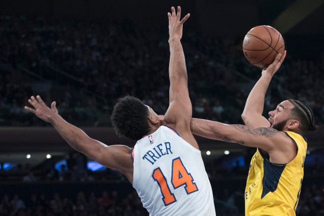 Indiana Pacers guard Cory Joseph, right, shoots as New York Knicks guard Allonzo Trier defends during the first half of an NBA basketball game Wednesday, Oct. 31, 2018, at Madison Square Garden in New York.