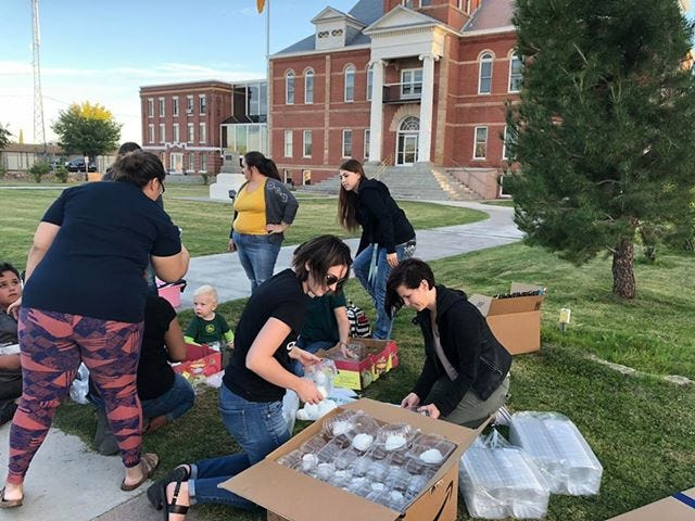Moms gathered at the Luna Courthouse park to unload sugar skulls that will be available for decorating at the Dia de los Muertos Art Festival on Saturday.