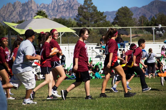 Students from Sierra Middle School take to the field during their flag football game in October, when they were recognized as a National Unified Champion School.