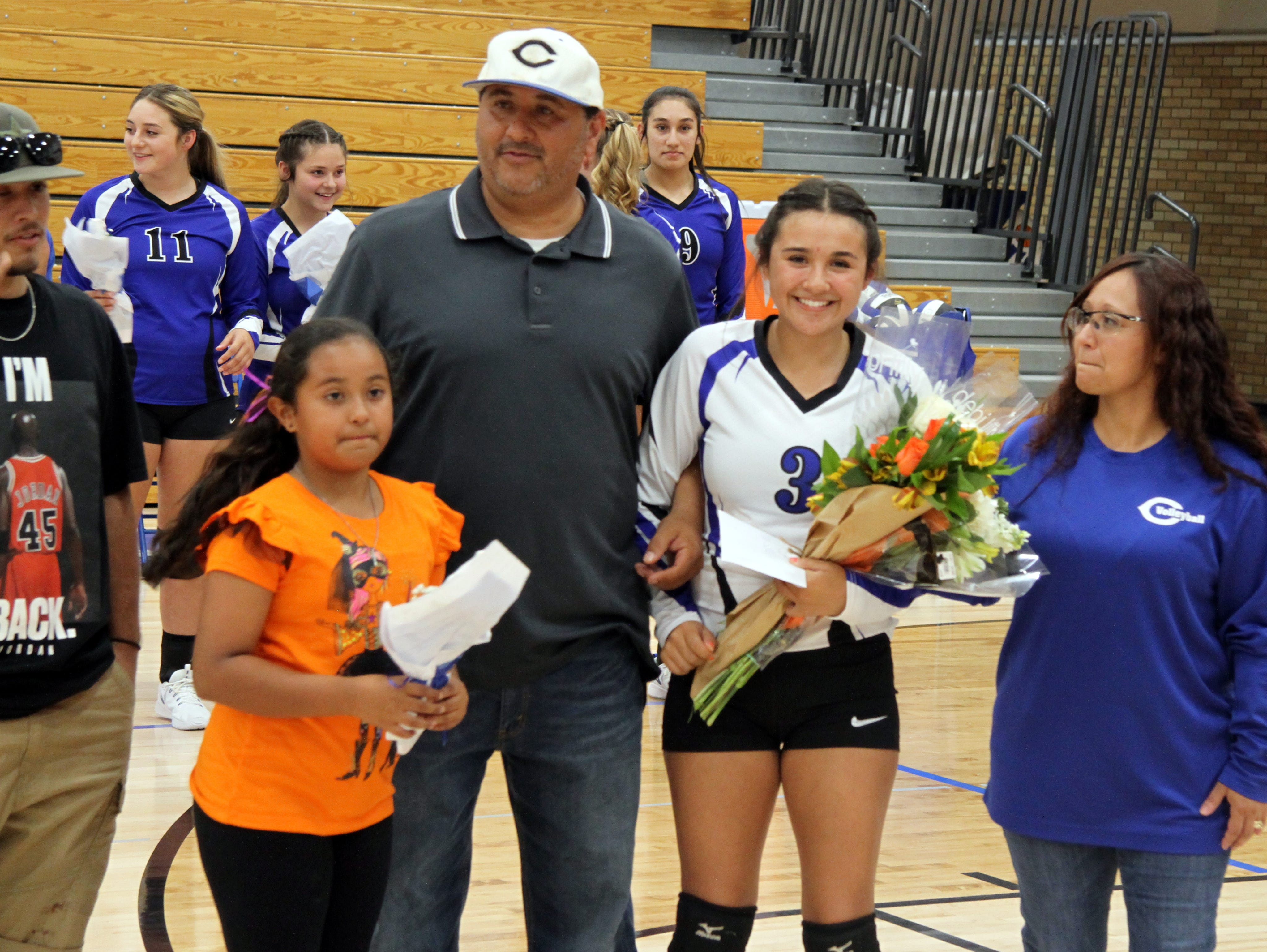 Marissa Reyes and her family before Tuesday's Senior Night match against Hobbs.