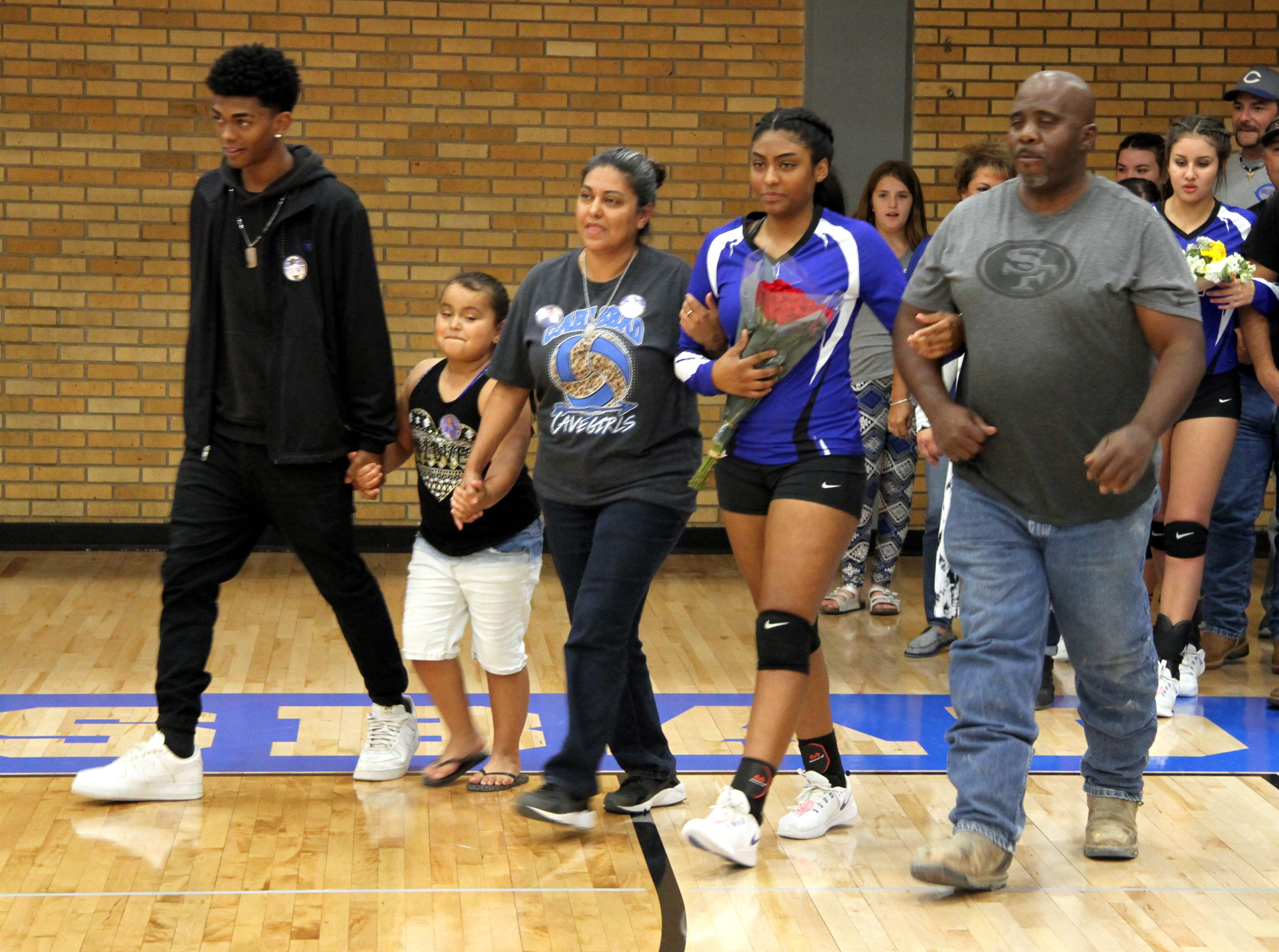 Destiny Young and her family before Tuesday's Senior Night match against Hobbs.