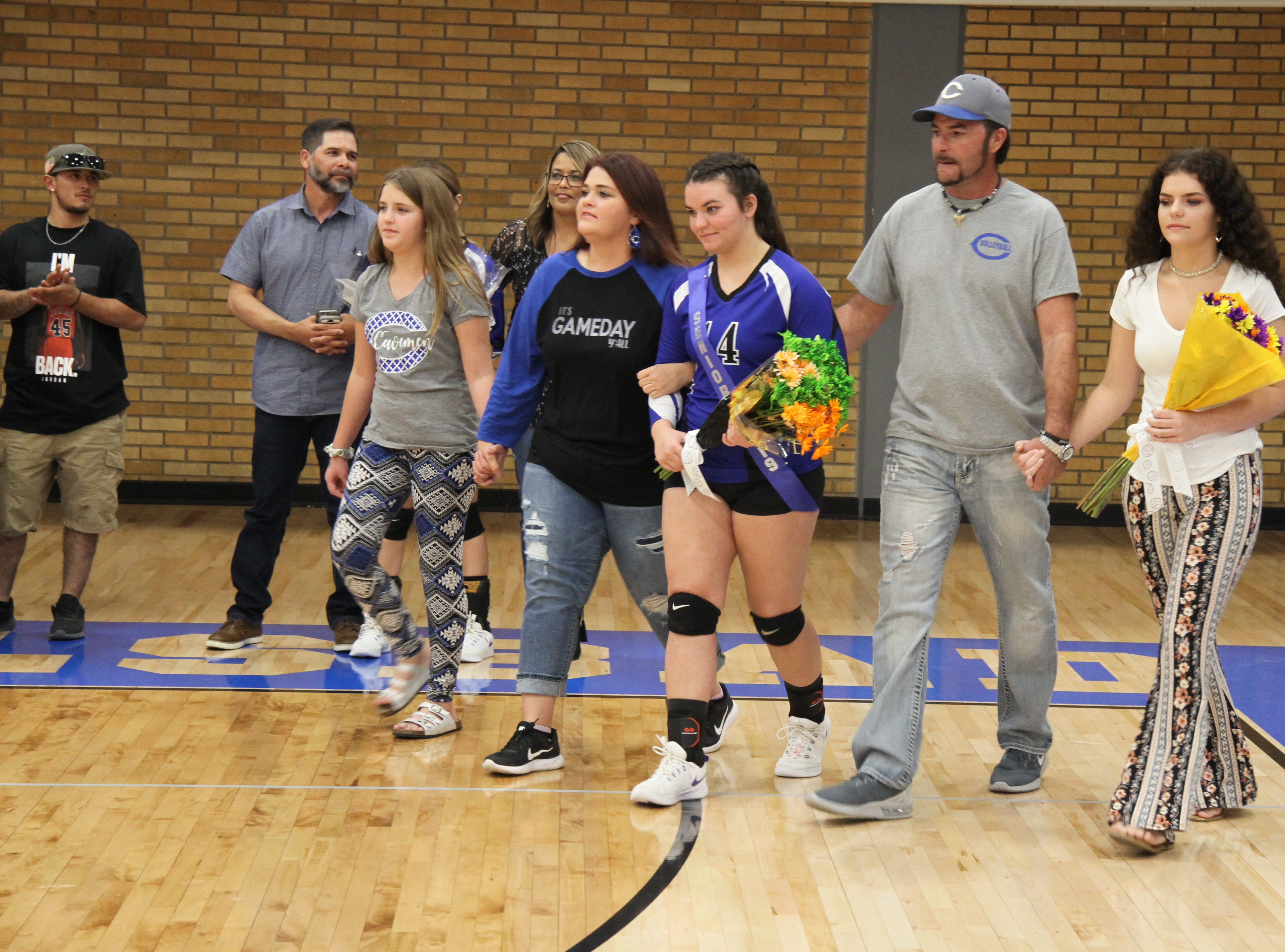 Danaye Boss and her family before Tuesday's Senior Night match against Hobbs.