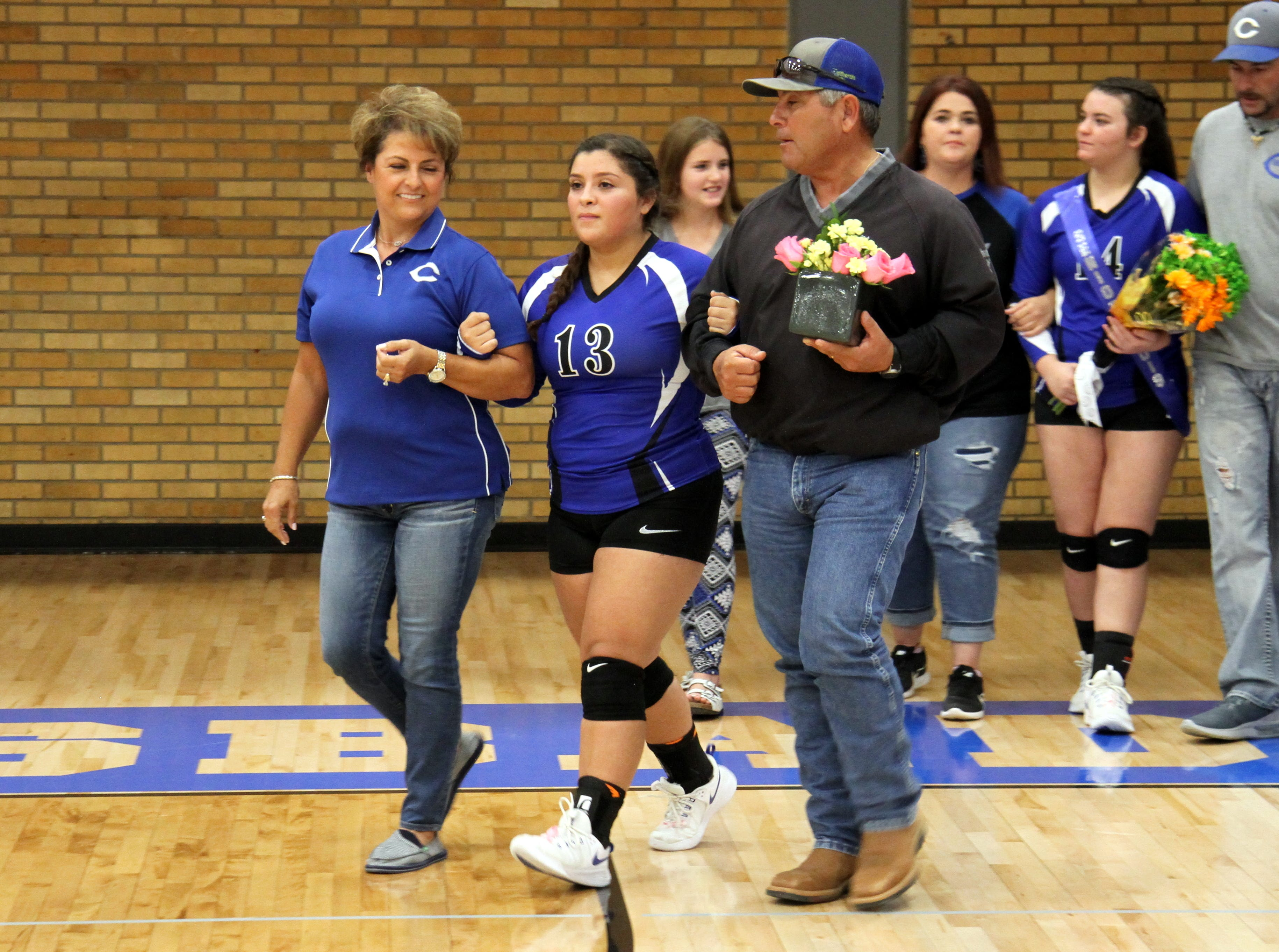 Kristina Torres and her family before Tuesday's Senior Night match against Hobbs.