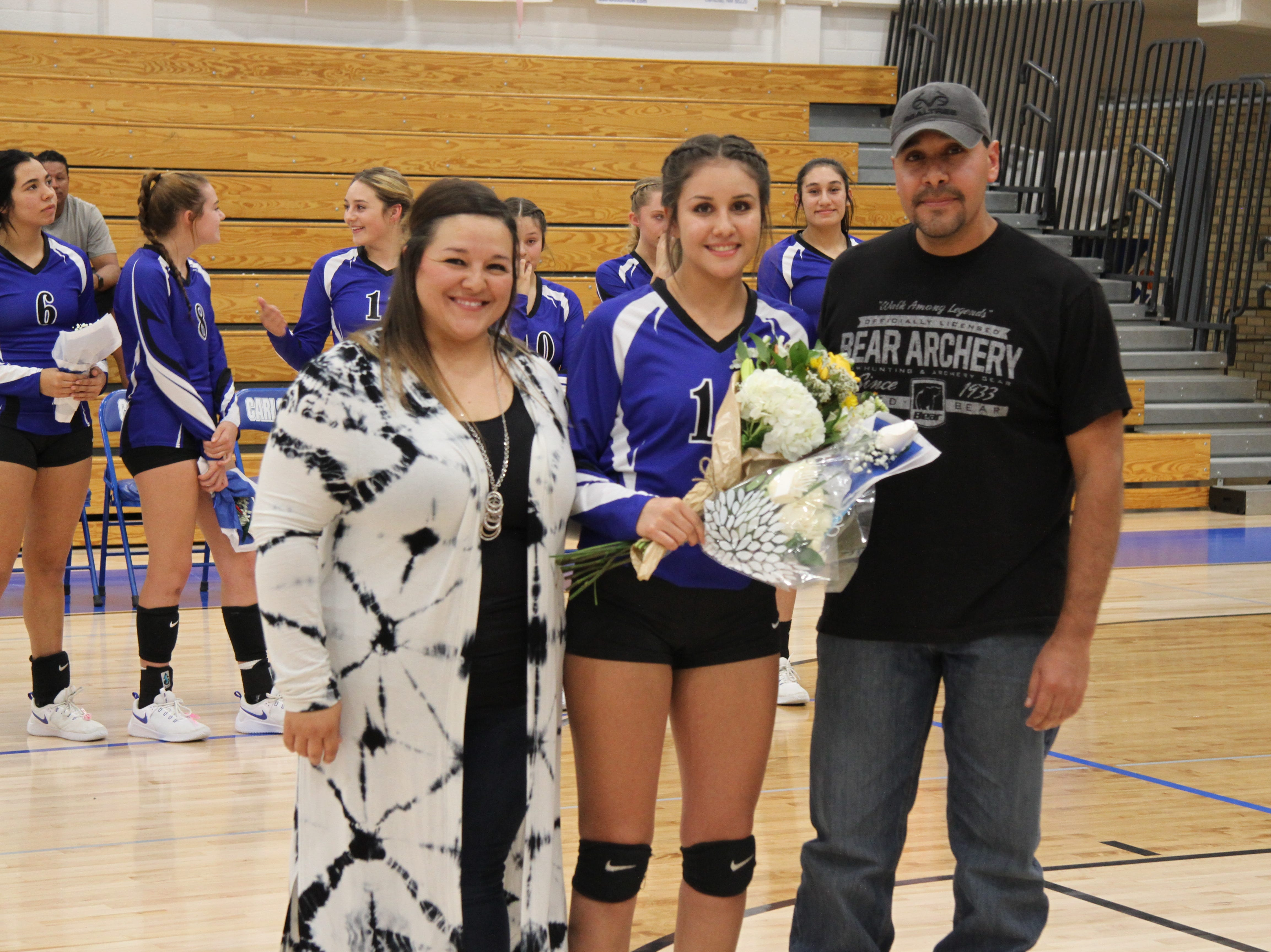 Aerin Hernandez and her family before Tuesday's Senior Night match against Hobbs.