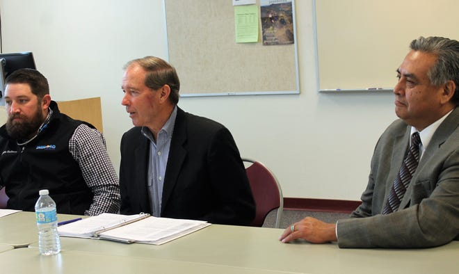From left: Ruidoso Director of Tourism Justin Huffmon, U.S. Senator Tom Udall and Mescalero Apache Telecom General Manager Godfrey Enjady at Udall's rural broadband roundtable at NMSU-A Tuesday.