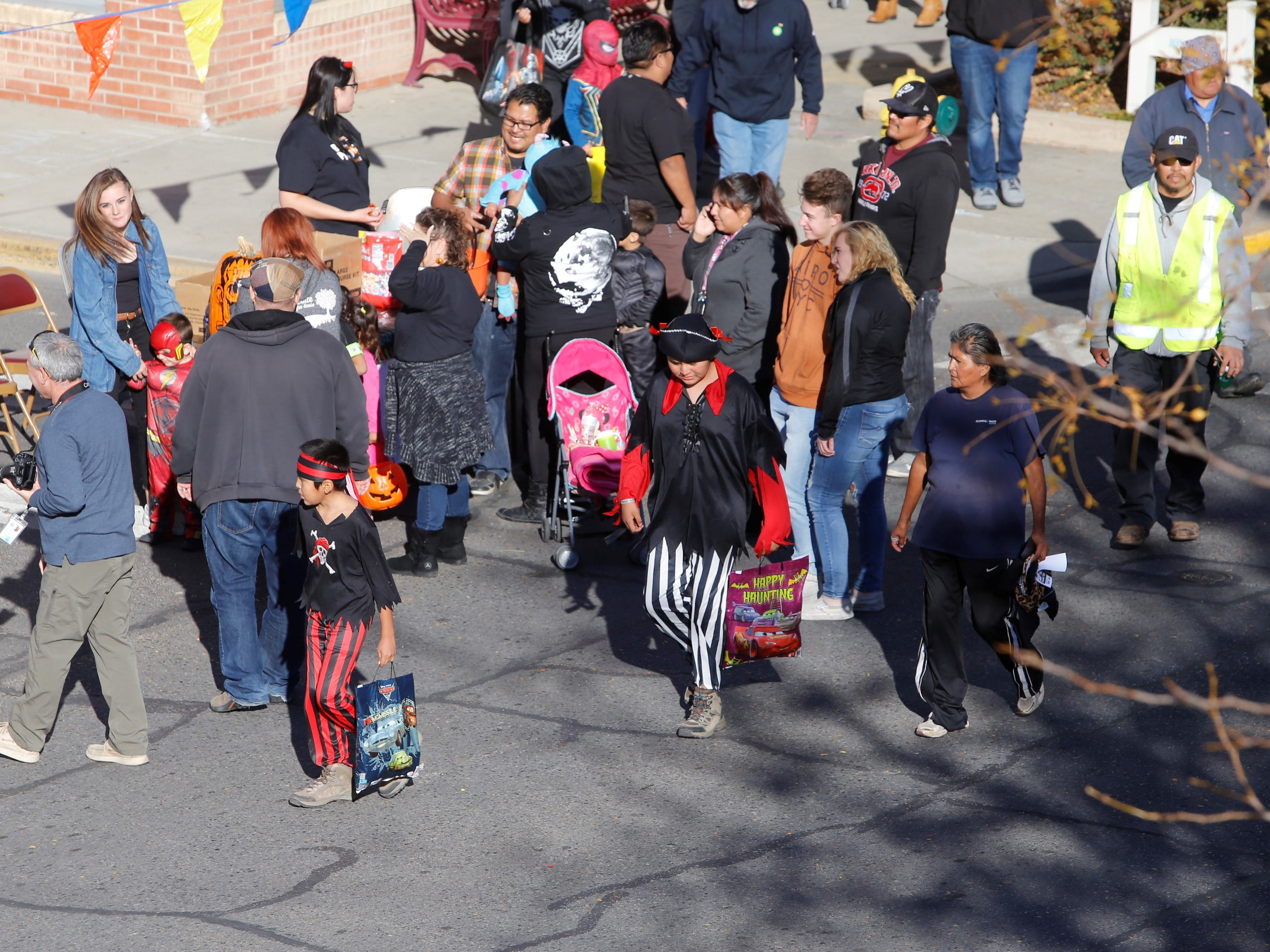 Trick or treaters walk down Main Street during BooPalooza Wednesday in Farmington.