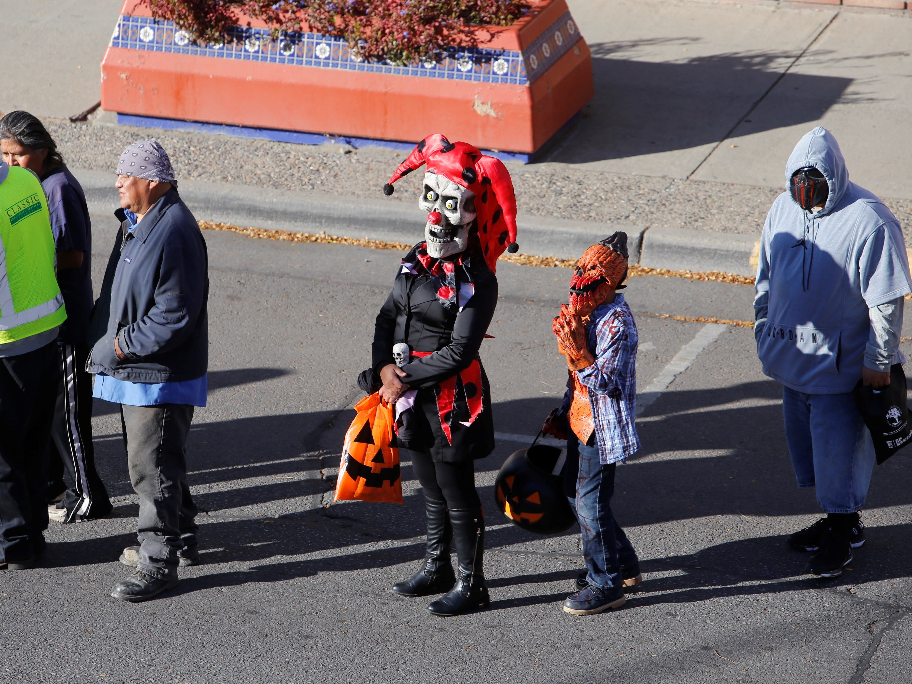 Trick or treaters line up to get candy at Tales of Tomorrow Comics walking down Main Street during BooPalooza Wednesday in Farmington.