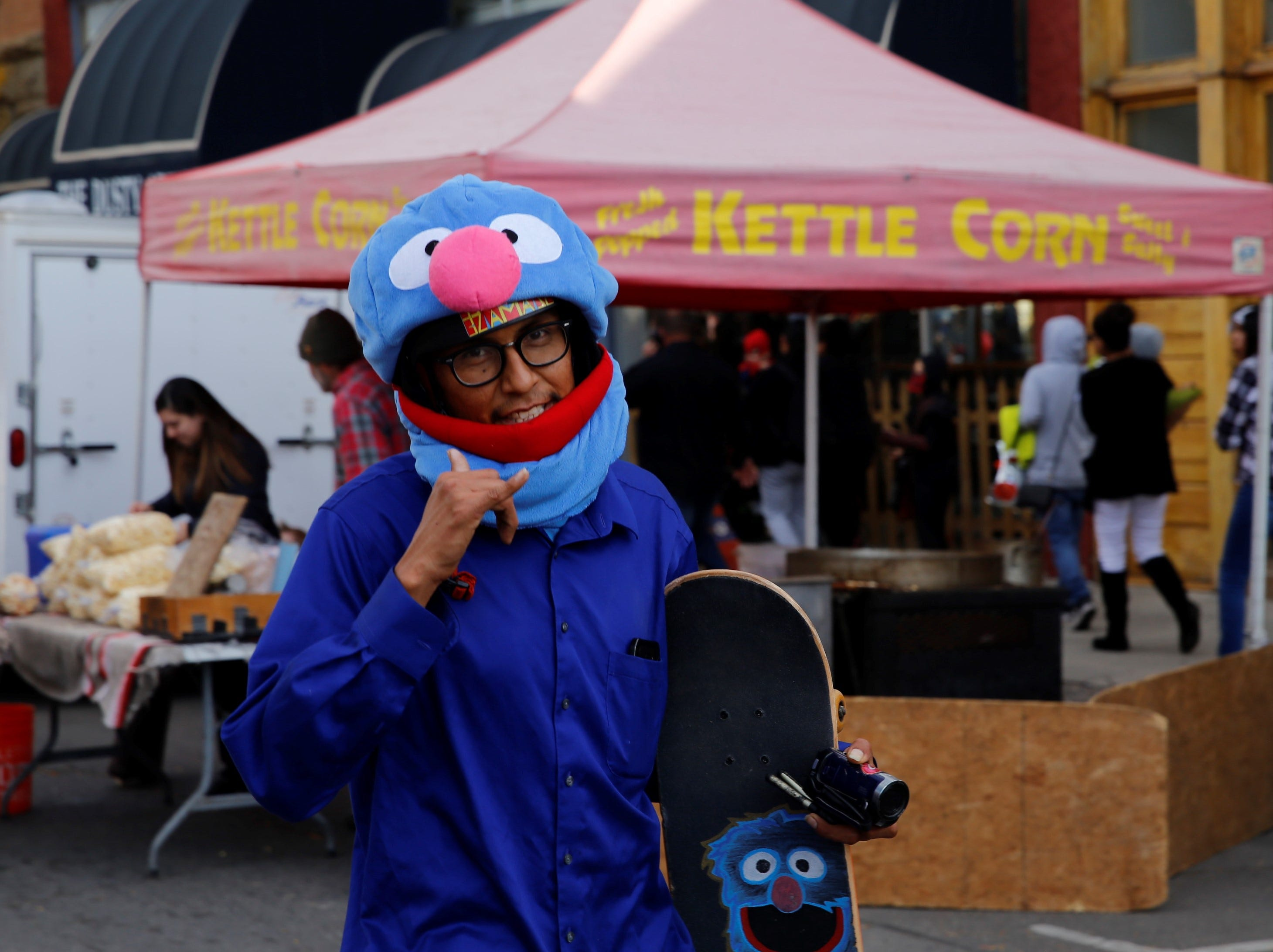 "Shawn Harrison, dressed as Grover from ""Sesame Street,"" walks down Main Street during BooPalooza Wednesday in Farmington."