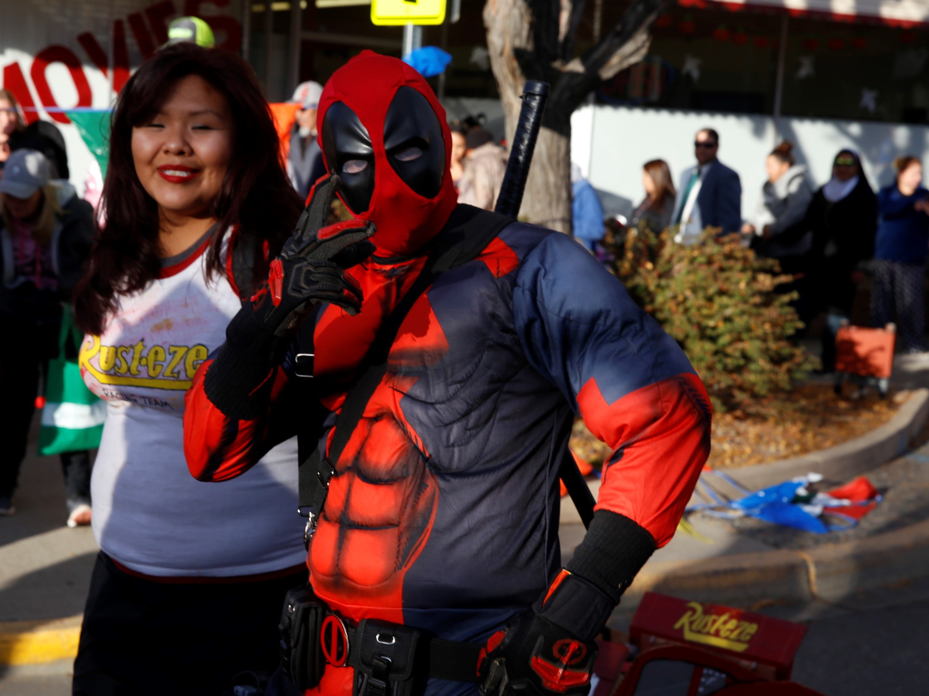 Dusty John, dressed as Deadpool, poses while walking down Main Street during BooPalooza Wednesday in Farmington.