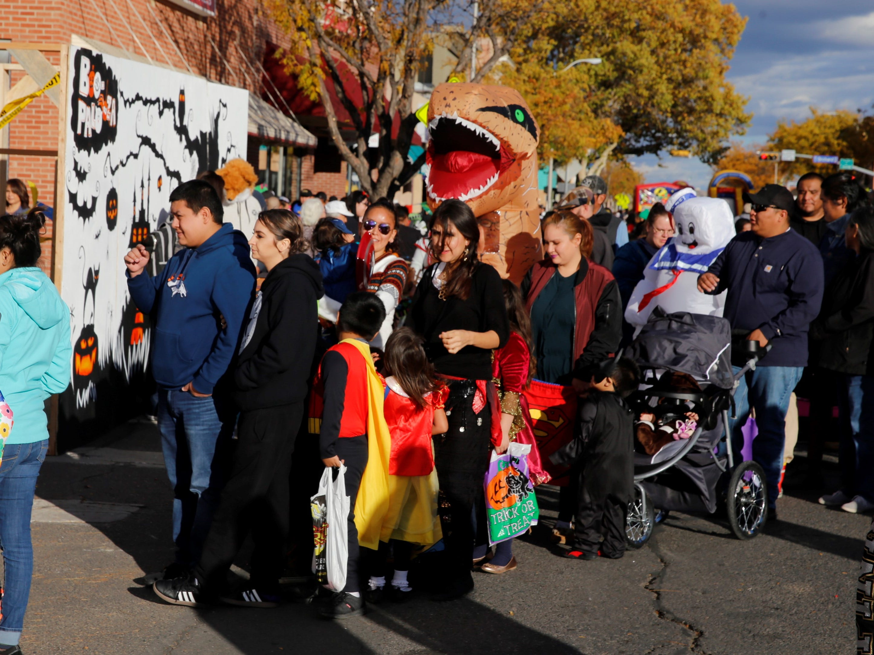 Trick or Treaters wait in line to get candy on Main Street during BooPalooza Wednesday in Farmington.
