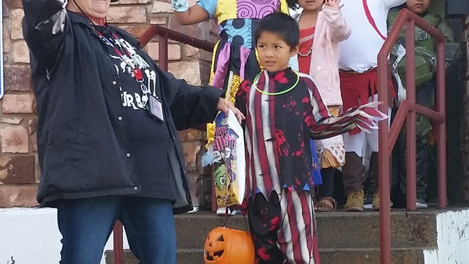 Leaving Indian Health Services, even Halloween villains were smiling because of their candy haul.