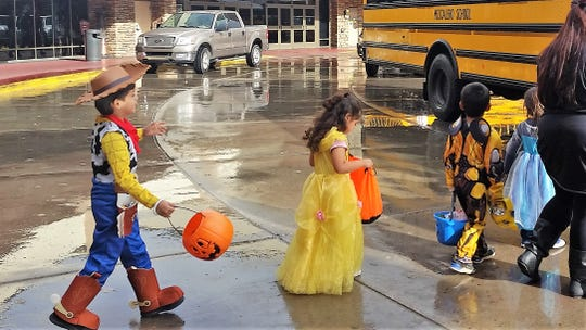 Plastic pumpkins held precious sweet treats for these students leaving the Inn of the Mountain Gods.