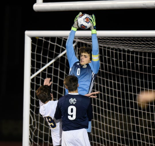 Detroit Country Day GK Jon Dougherty (0) makes a save during Division 2 state semifinal game played Oct. 31, 2018 at Farmington High School.
