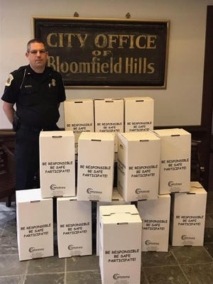 Bloomfield Hills Public Safety Lt. Jeff Gormley with boxes of unneeded prescriptions turned in by the public and headed for proper disposal.