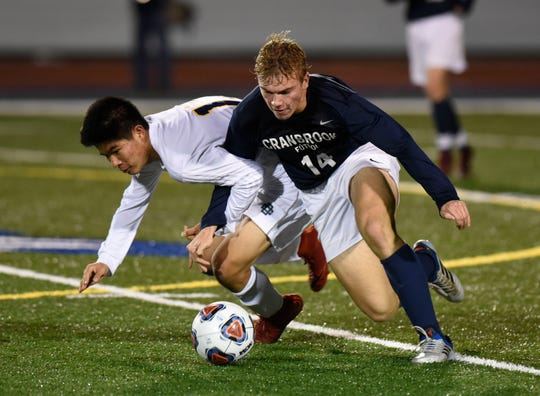 Detroit Country Day F Kevin Tang (10) and Cranbrook M Clark Doman (14) during Division 2 state semifinal game played Oct. 31, 2018 at Farmington High School.