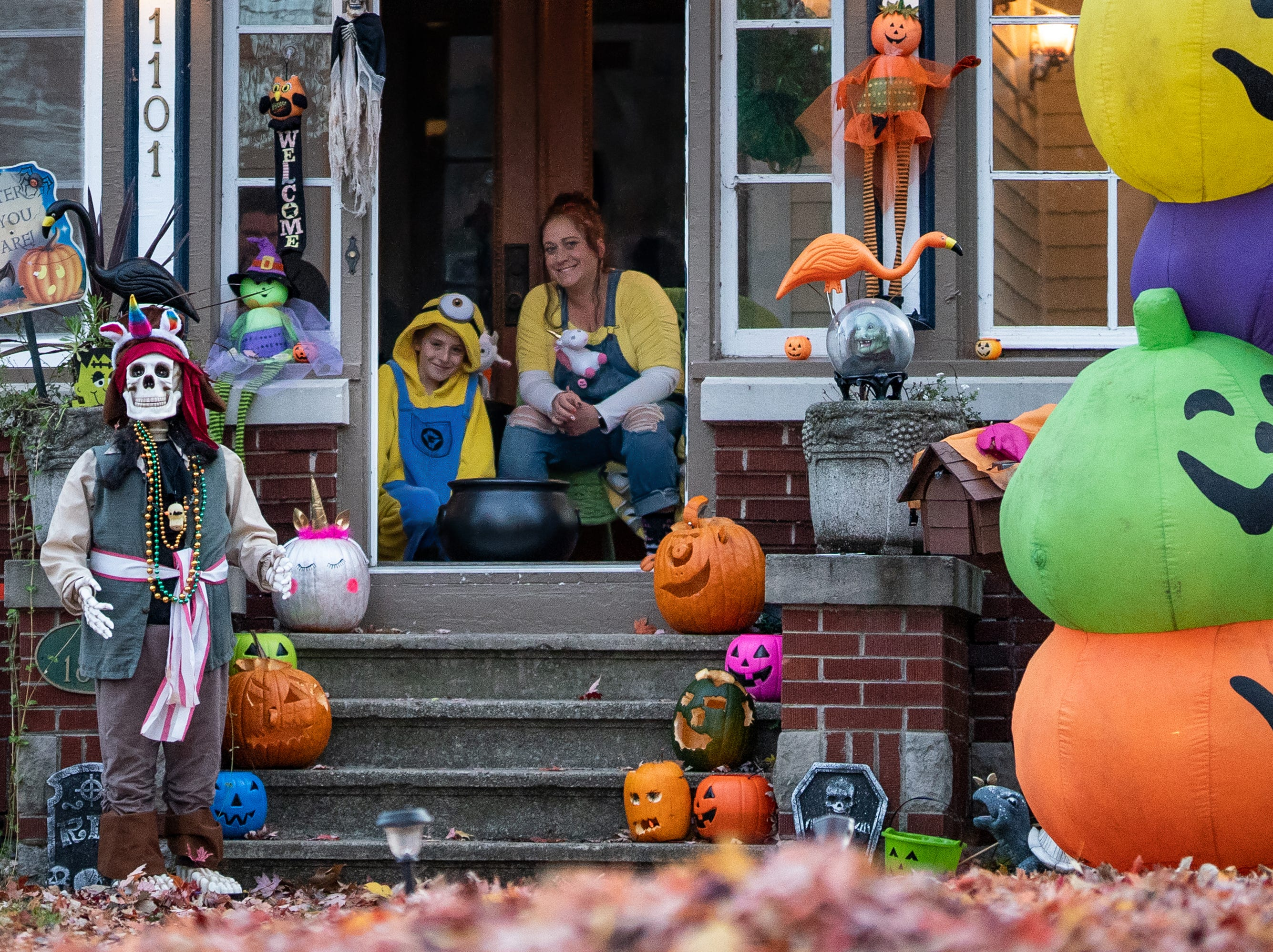 Titus Schroeder and his mother wait on their Merritt Avenue porch for trick or treaters. Children, along with their parents, made the most of the beautiful autumn weather to trick or treat in Oshkosh Wednesday evening.