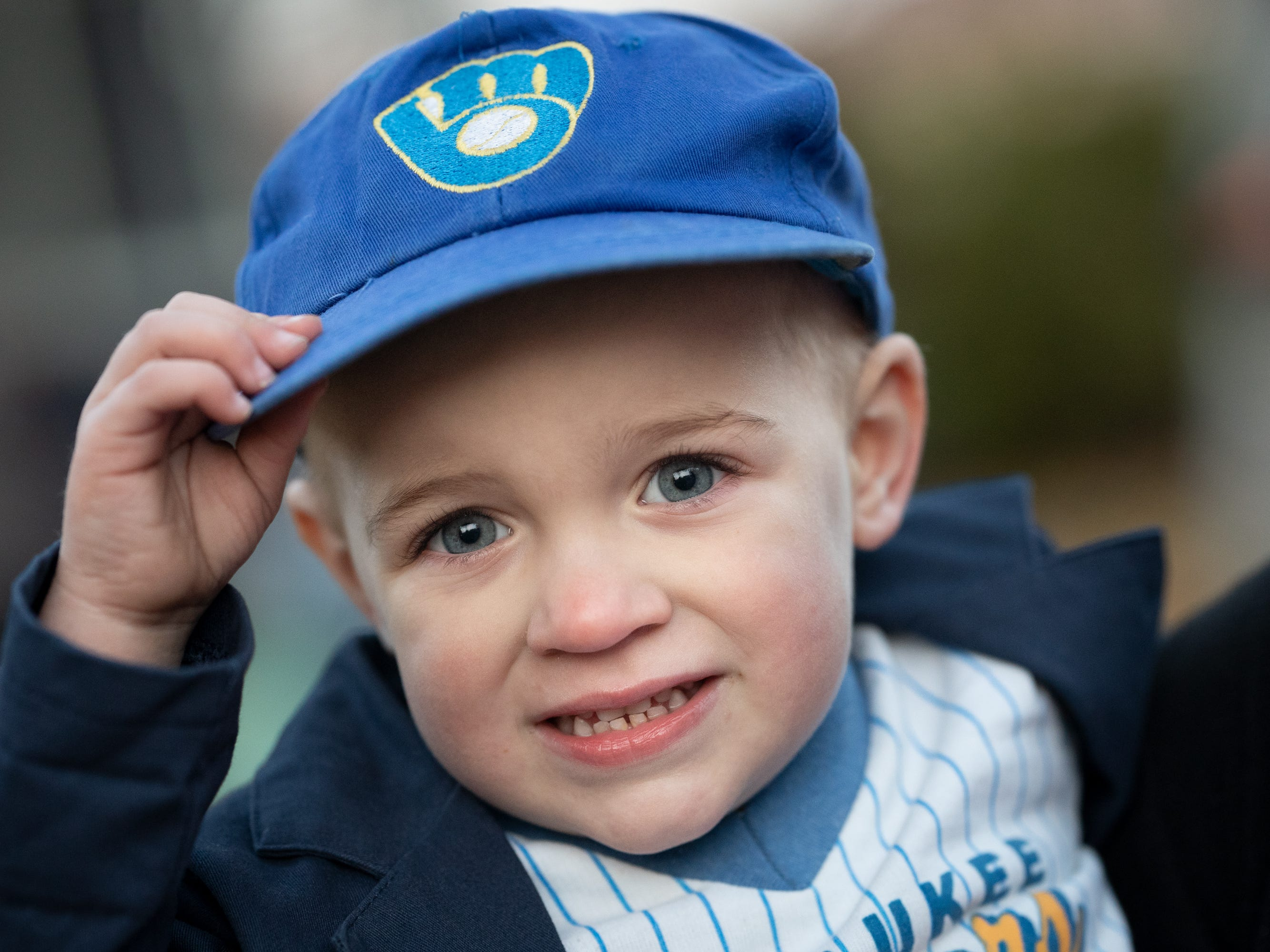 Thatcher Campbell shows off his Milwaukee Brewer costume. Children, along with their parents, made the most of the beautiful autumn weather to trick or treat in Oshkosh Wednesday evening.