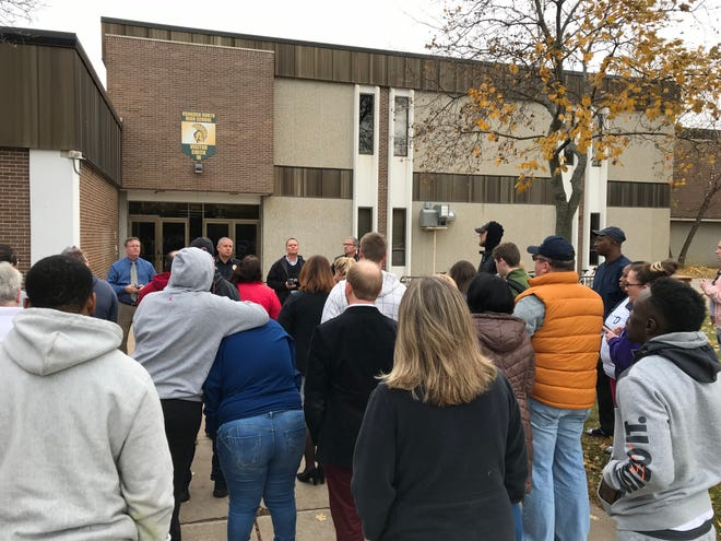 Oshkosh police and school officials address parents Thursday, Nov. 1, 2018, at Oshkosh North High School. The school went on lockdown for about an hour after police thought a student might have brought a gun to school.