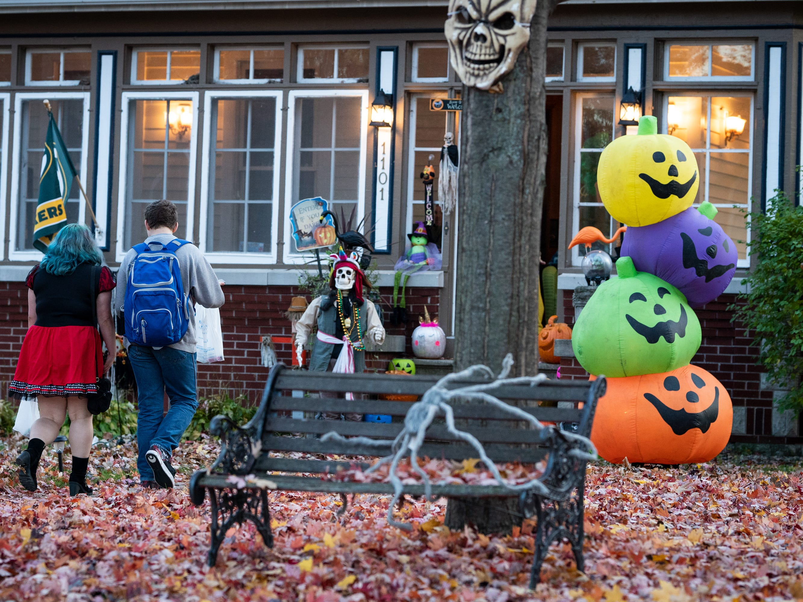 Trick or treaters walk up to a very decorated house on Merritt Avenue. Children, along with their parents, made the most of the beautiful autumn weather to trick or treat in Oshkosh Wednesday evening.