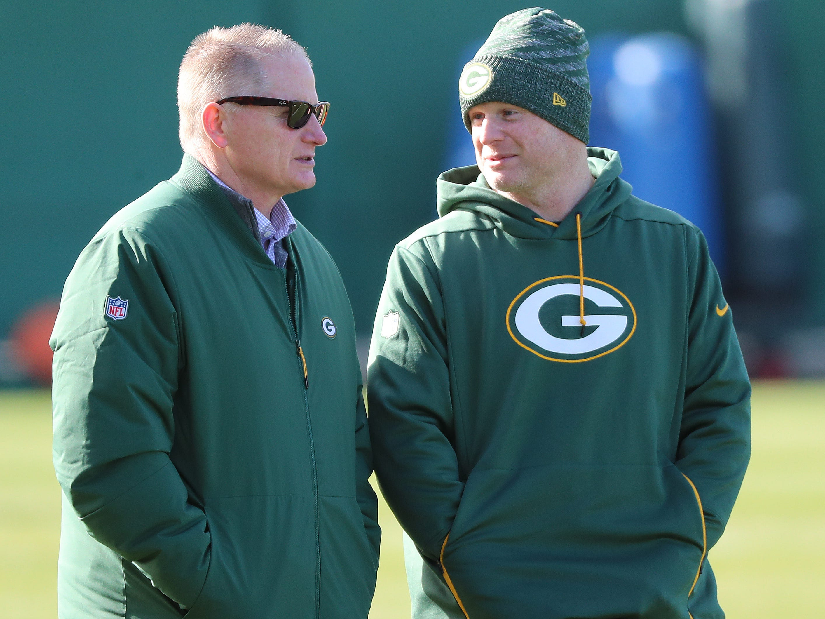 Packers general manager Brian Gutekunst, right, chats with Director of Football Operations Russ Ball during practice on Clarke Hinkle Field Thursday, November 1, 2018 in Ashwaubenon, Wis.