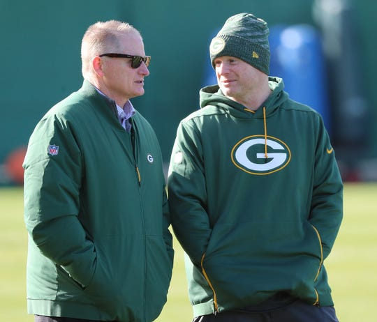 Packers general manager Brian Gutekunst, right, chats with director of football operations Russ Ball during practice on Clarke Hinkle Field on Nov. 1.