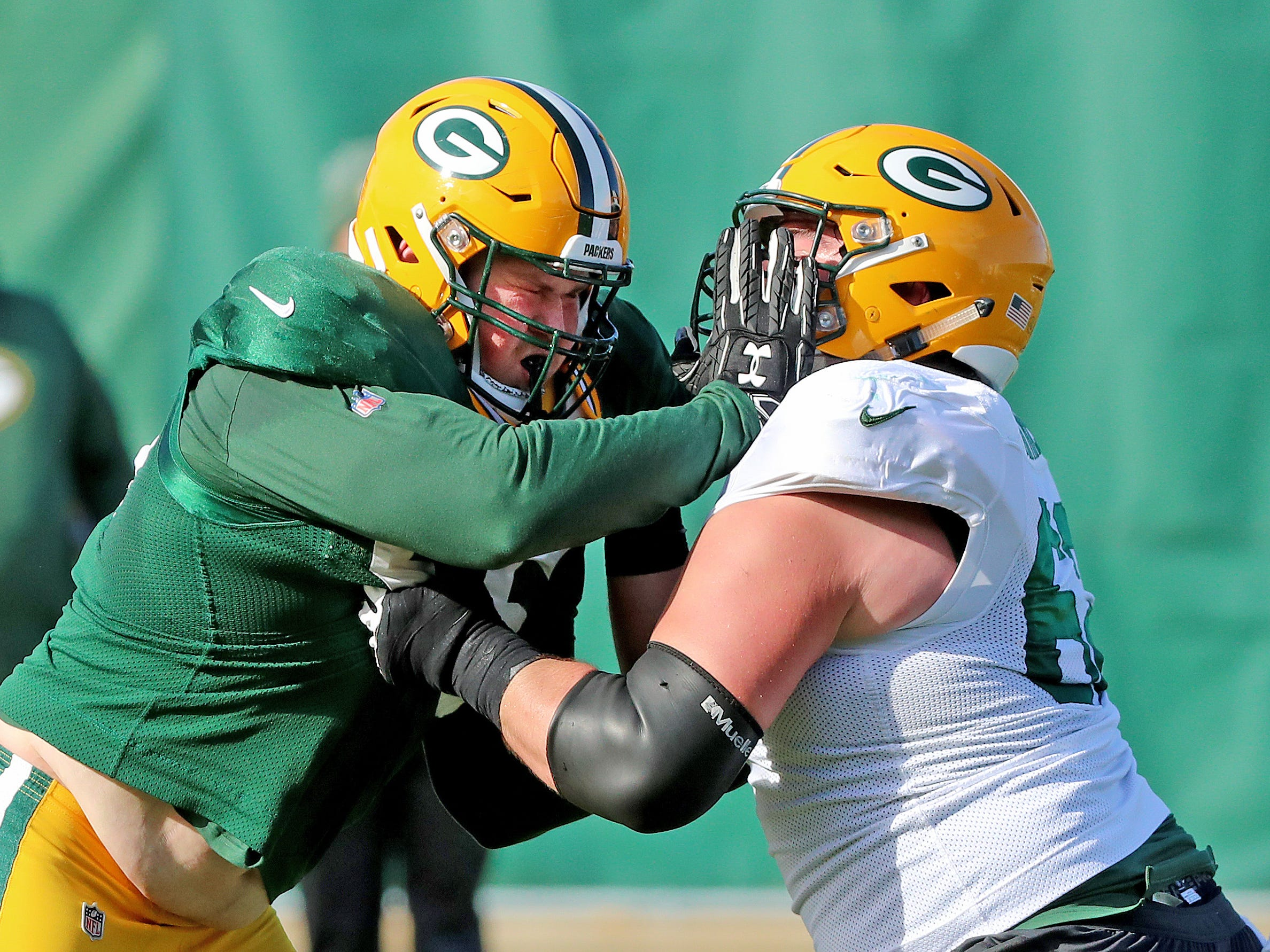 Green Bay Packers offensive guard Lucas Patrick (62) battles defensive tackle Tyler Lancaster (95) during practice on Clarke Hinkle Field Thursday, November 1, 2018 in Ashwaubenon, Wis.