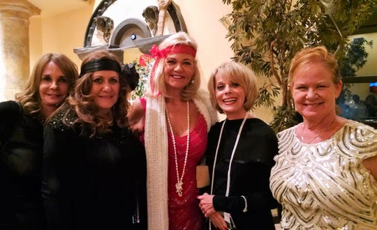 Death by Chocolate goers (from left) are Les Dames members Kay Bogeajis, President Lisa Wherry, guest Cheryl Kaufmann, member Janet Harris and Treasurer Kathy Schriefer.