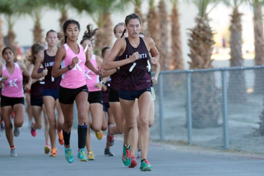 La Quinta's Emmi Von Scherr leads the leads the race and goes on tp win the Desert Empire League girls varsity cross country title on Wednesday, October 31, 2018 in Palm Desert.