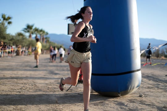 Xavier Prep's Molly May is second in the Desert Empire League varsity girls cross country title race on Wednesday, October 31, 2018 in Palm Desert.
