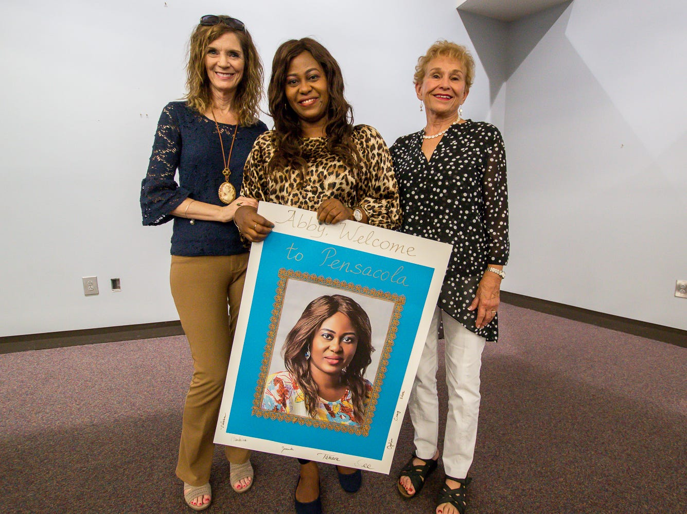 The Great Gulfcoast Arts Festival's Invited International Artist Abigail Nnaji, of Abuja, Nigeria, center, poses for a photo with GGAF committee members Tamara Mitchell, left, and Dee Green, right, before her presentation in the Anna Lamar Switzer Building at Pensacola State College on Tuesday, October 30, 2018.