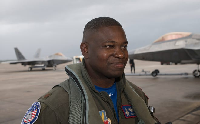 Maj. Paul Lopez, an Air Force F-22 Raptor pilot, arrives Thursday at Naval Air Station Pensacola. The jets, which are based out of Langley Air Force Base, are in town to take part in this weekend's Blue Angels Homecoming Air Show.