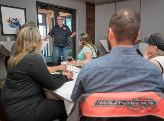 Thunder Beach Productions owner Joe Biggs, top, talks about the upcoming Thunder Beach Motorcycle Rally during a meeting Thursday at the Grand Marlin restaurant.