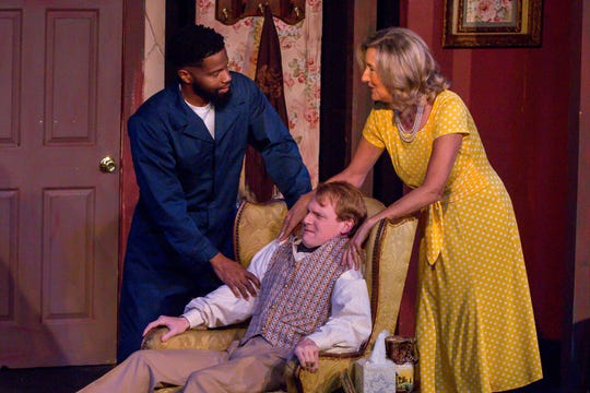 """Gene Alexander, playing Tom, far left, Nathan Toepfer, playing Lawrence, and Connie Cali, playing Amanda Wingvalley, rehearse their scenes at Pensacola Little Theatre on Monday, October 29, 2018. They are part of """"Desire Desire Desire/For Whom The Southern Belle Tolls,"""" two one-act plays written by Christopher Durang."""